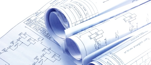 Rolls of printed blueprints or architectural plans.