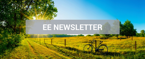 summer field with bicycle and newsletter title